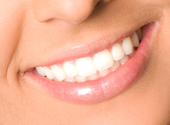 Healthy woman teeth and smile close up.j