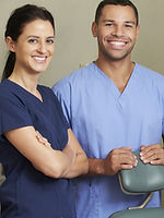 A photo of a male and female dentist together