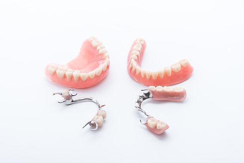 Set of dentures on white background.jpg