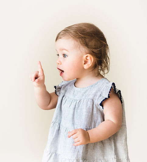 baby-girl-pointing-her-finger-excited-78