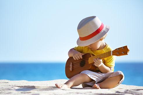 little-boy-plays-on-hawaiian-guitar-6066