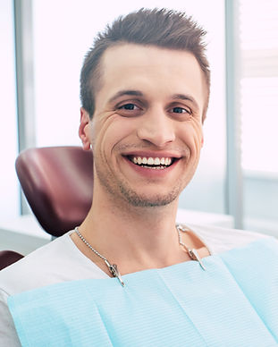 Ace it! Man  in the dental chair  with a