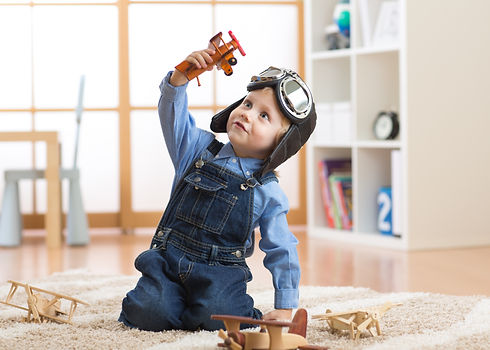 happy-child-toddler-boy-playing-toy-5589