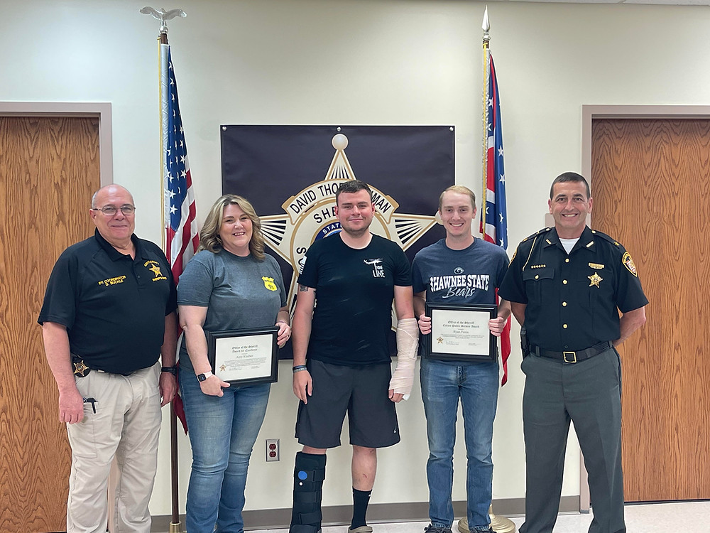 Sheriff David Thoroughman is pictured with (left to right) Emergency Communication's Supervisor Doug Buckle, Emergency Communication's Dispatcher Amy Klaiber, Deputy Trevor Webster, and Ryan Penix.