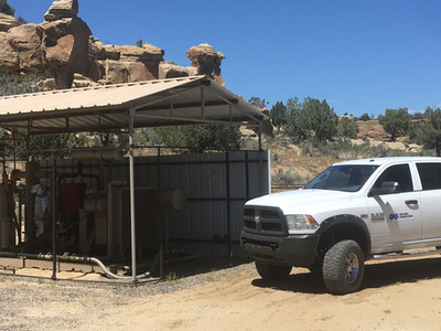 San Juan Compression Service Truck on location of Wellhead Compressor Unit in Environmental Conscious location