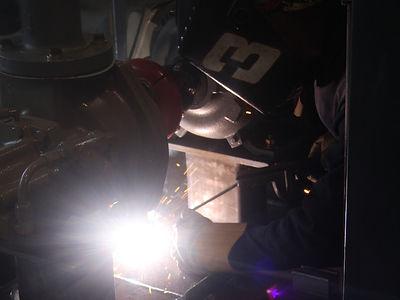 San Juan Compression manufacturing shop welding on natural gas compressor