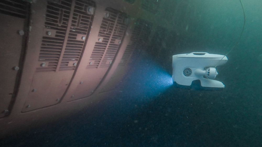Blueye drone inspecting a ship's hull underwater