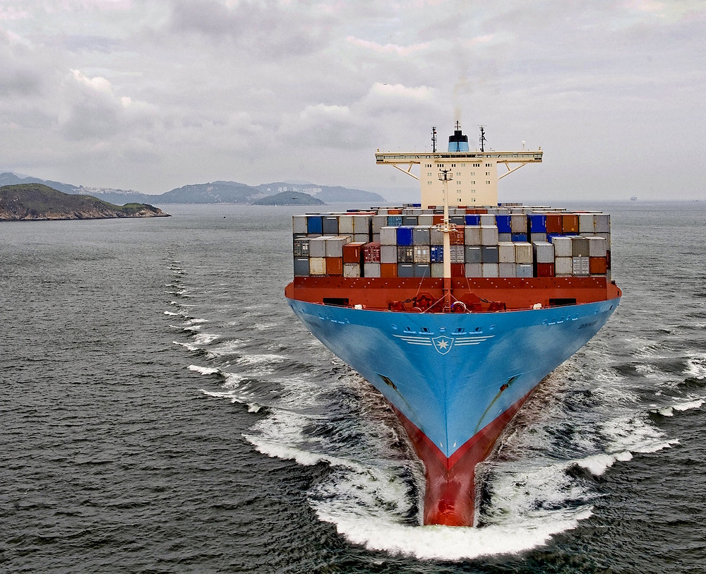 Maersk containership on the ocean heading toward the camera
