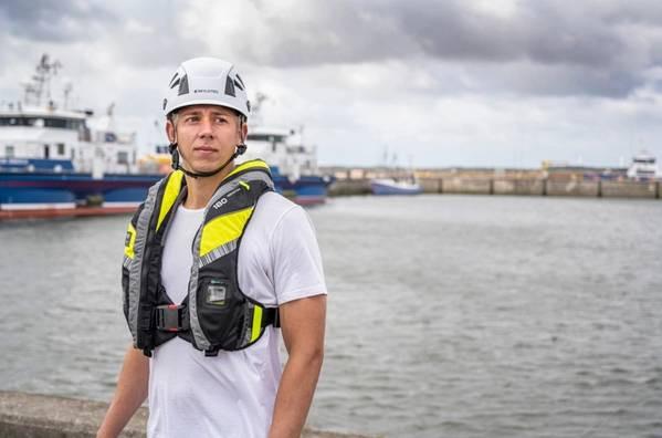Viking lifejacket on a human with a helmet on.