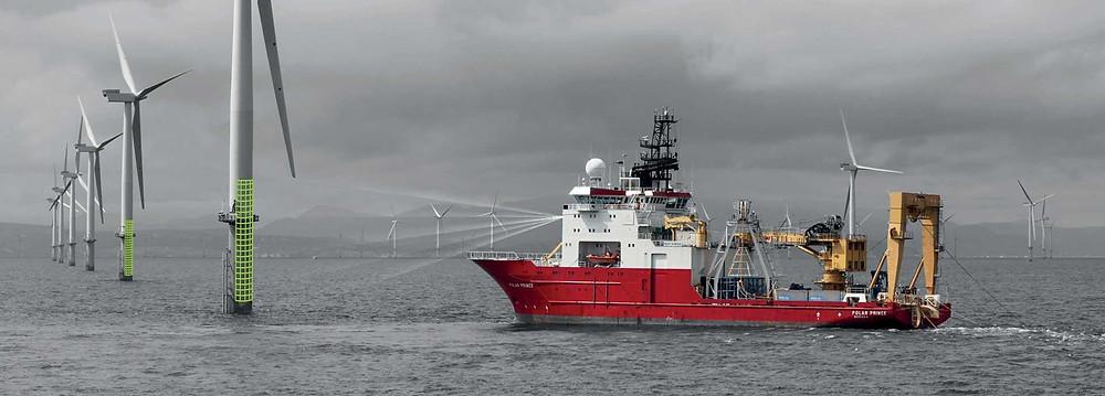 WTIV with laser range finding floating toward a wind turbine.