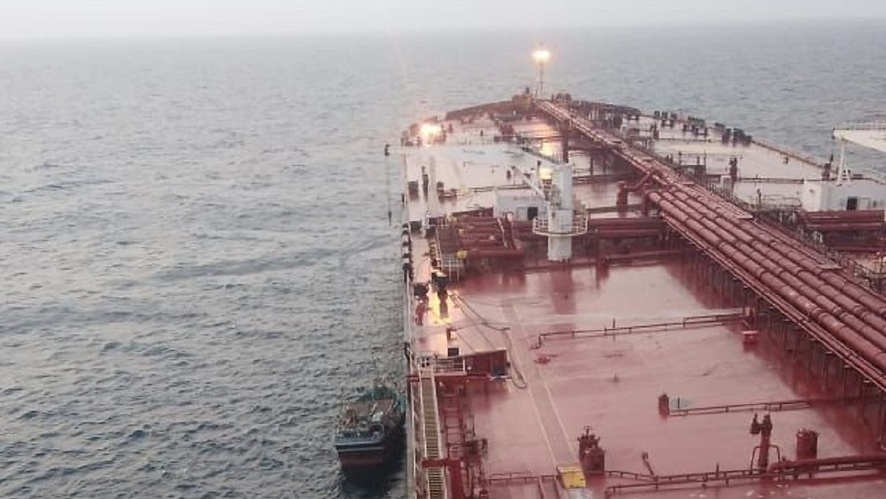 VLCC rescuing a fishing boat on the ocean