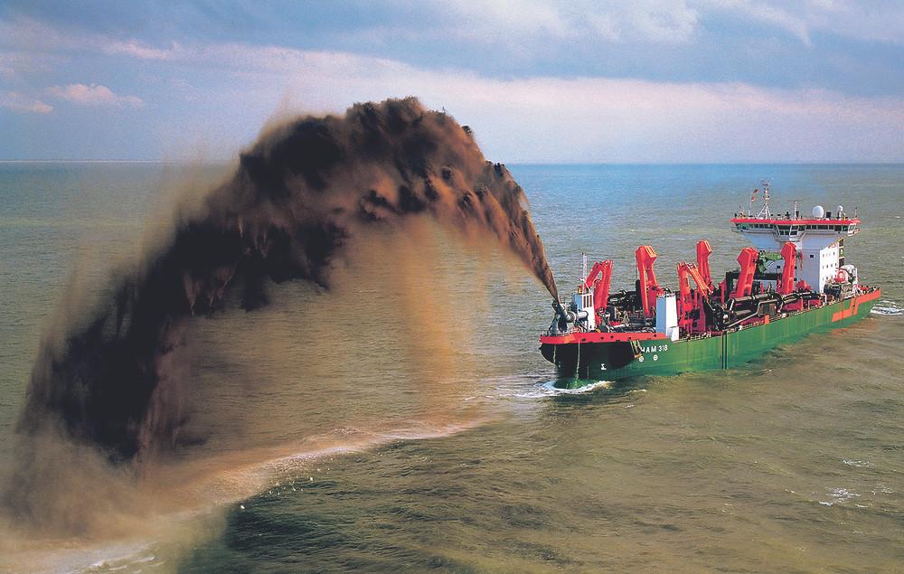 Dredger spraying sand