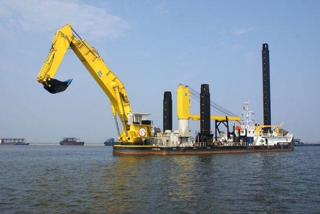 Backhoe dredger on the water