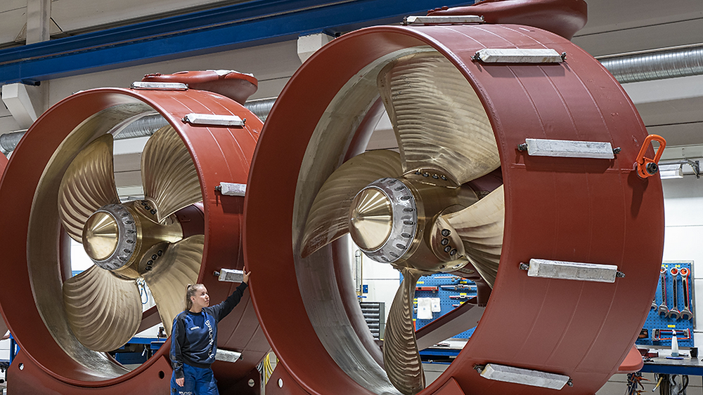 Azimuth Thrusters with a woman standing next to it