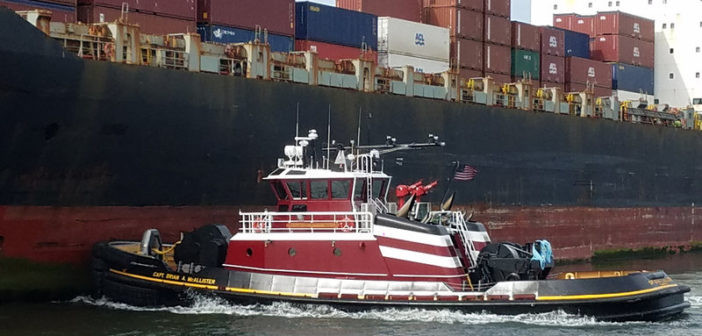 Tugboat pushing a container ship