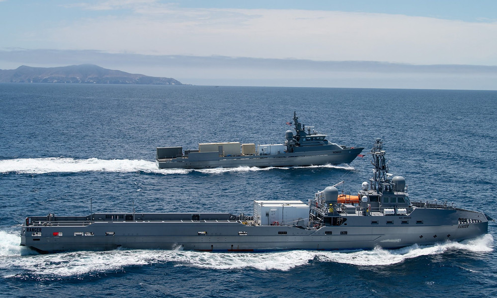 USV Nomad on the ocean with another Navy vessel