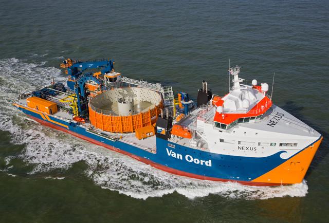 Cable lay vessel Van Oord Nexus on the ocean with an empty basket