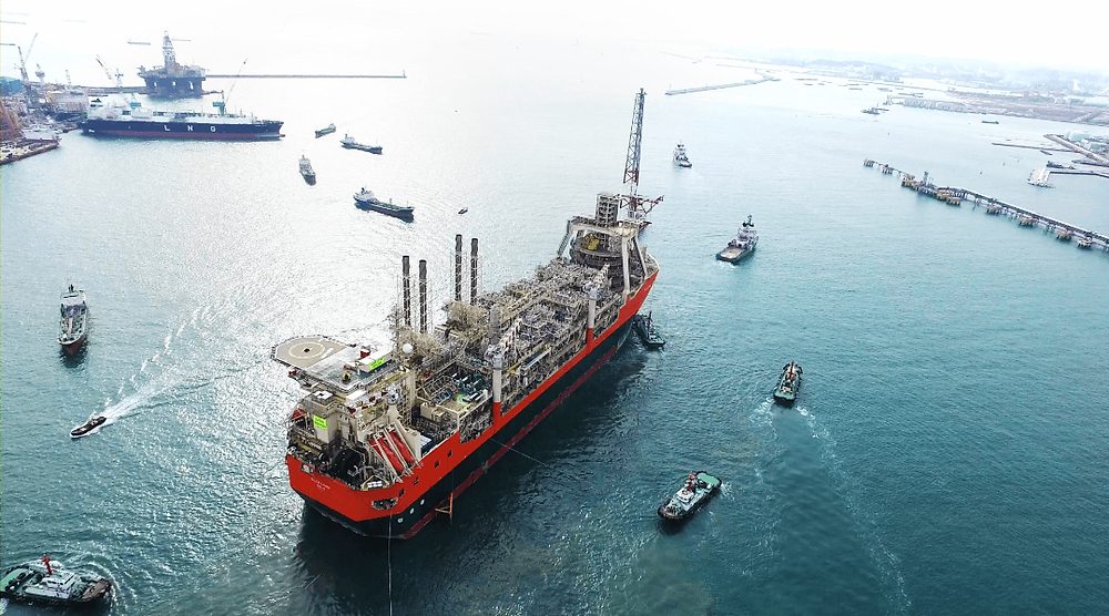Glen Lyon FPSO surrounded by tugs in a port