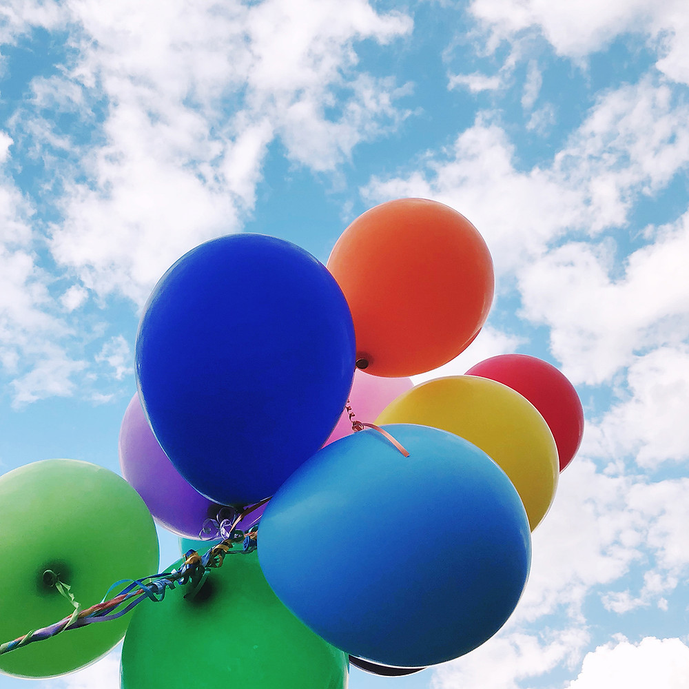 colorful balloons in a blue sky