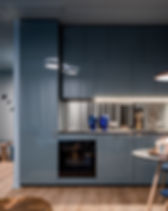 Dark home interior in blue with open kit