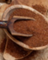 Uncooked teff grain in a bowl with a spo