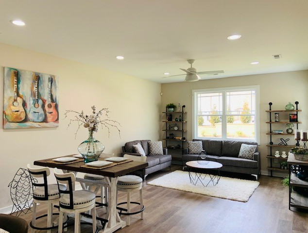 Open Concept Living and Dining Room lit with Abundant Light from Prarie Style Windows