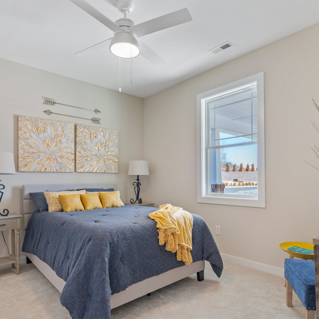 Spacious Second Bedroom Includes Hunter Fan, Carpet Flooring and Large Double Door Closet