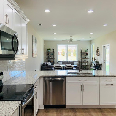 Kitchen includes Custom Built Soft Close Cabinets and Stainless Appliances