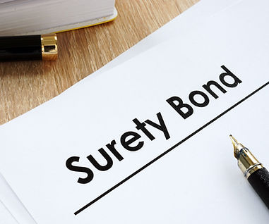 Surety%20bond%20form%20and%20pen%20on%20