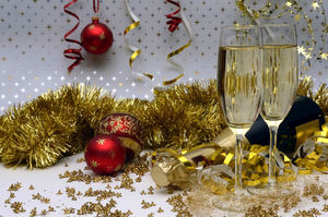 holiday-champagne-bottle-glasses-confetti-tinsel-ornaments