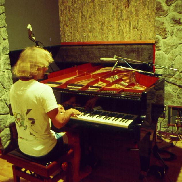 Gary on the Bosendorfer piano which sat inside a wall. Air Studios Montserrat