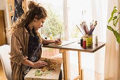 girl-painting-canvas-min.jpg