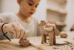 cute-boy-forming-toys-from-clay-min.jpg