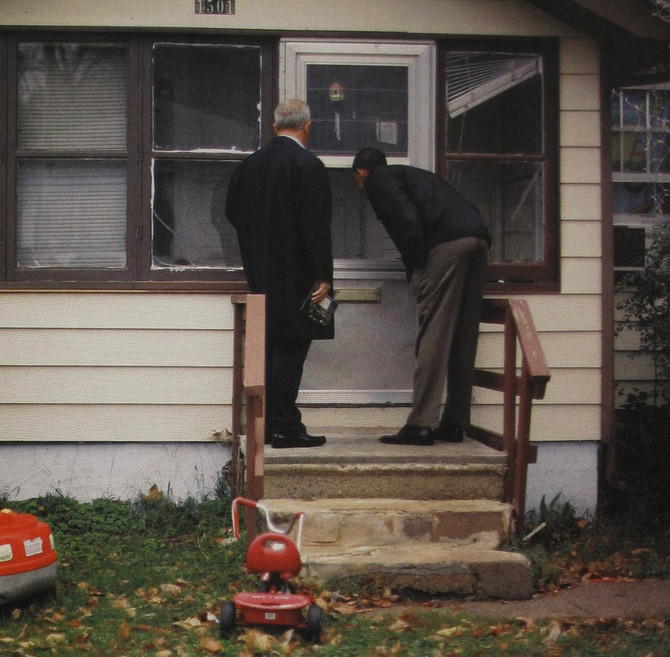 Barack Obama canvassing a Des Moines, Iowa neighborhood during presidential campaign, 2007