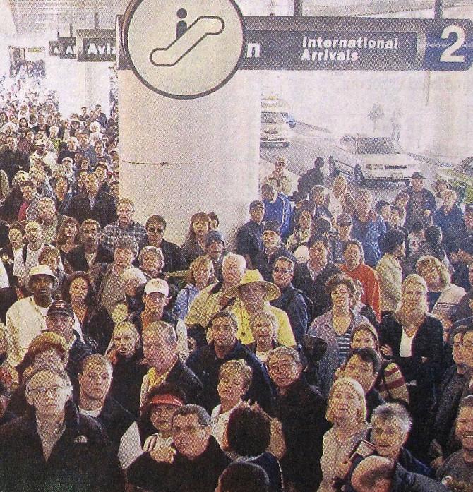 International Arrivals, Los Angeles, 2002 (photo by Nick Ut)