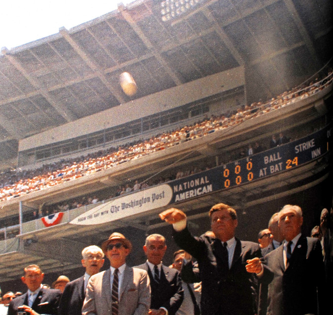 President Kennedy throwing ceremonial first pitch at Baseball All-Star Game, D.C. Stadium, Washingto