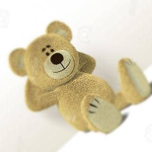 8352405-a-cute-teddy-bear-relaxes-sittin