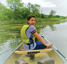 REACH Peer Mentor Lina Smiling in a Kayak