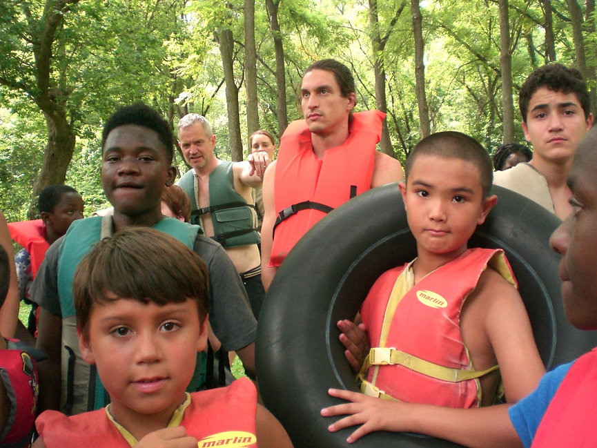 REACH youth and volunteers preparing to go river tubing