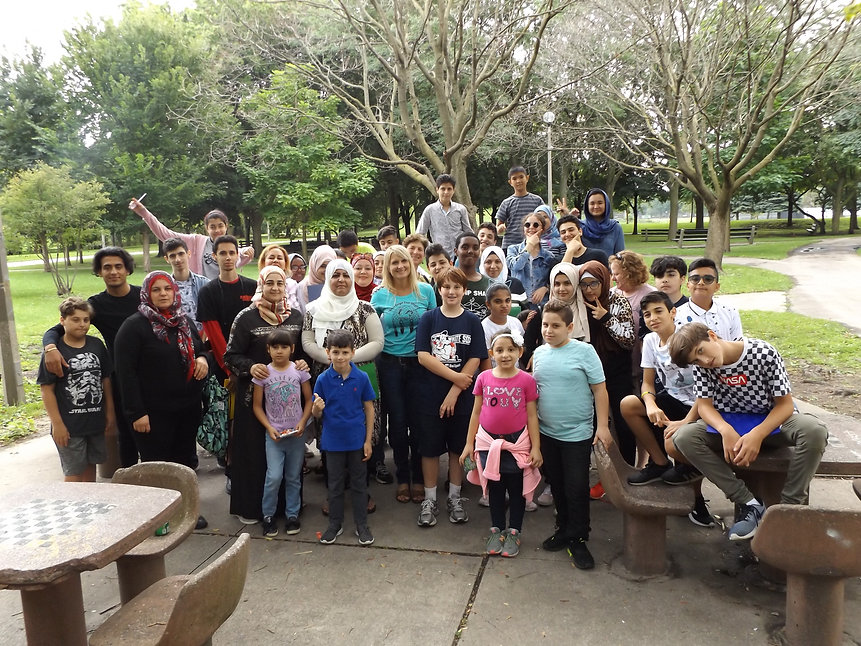 Large group of REACH youth and volunteers in a park