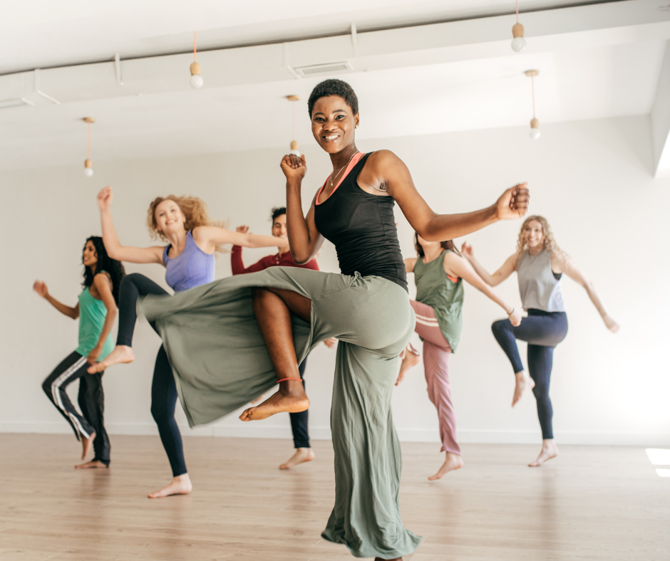 Women doing a dancing aerobic exercise in a light colored studio