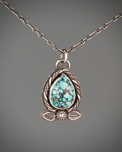 Kingman Turquoise necklace with twisted wire, leaf and flower stamping