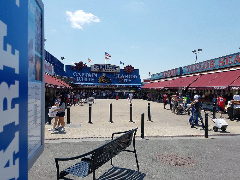people and outdoor food stands and restaurants outside the District Wharf, Washington, DC