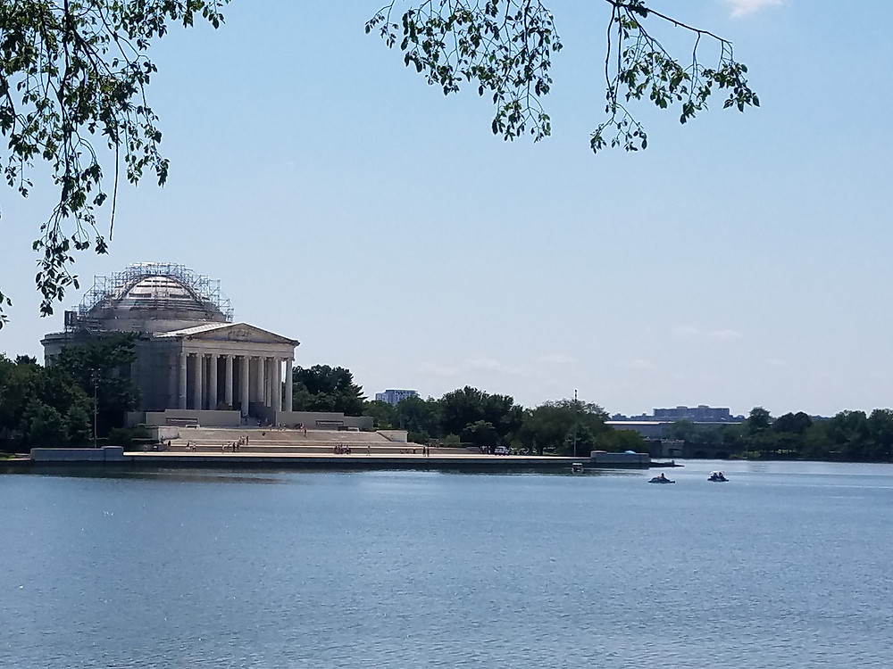 View across the Tidal Basin of the Thomas Jefferson Memorial, Washington, D.C. with kayakers in foreground