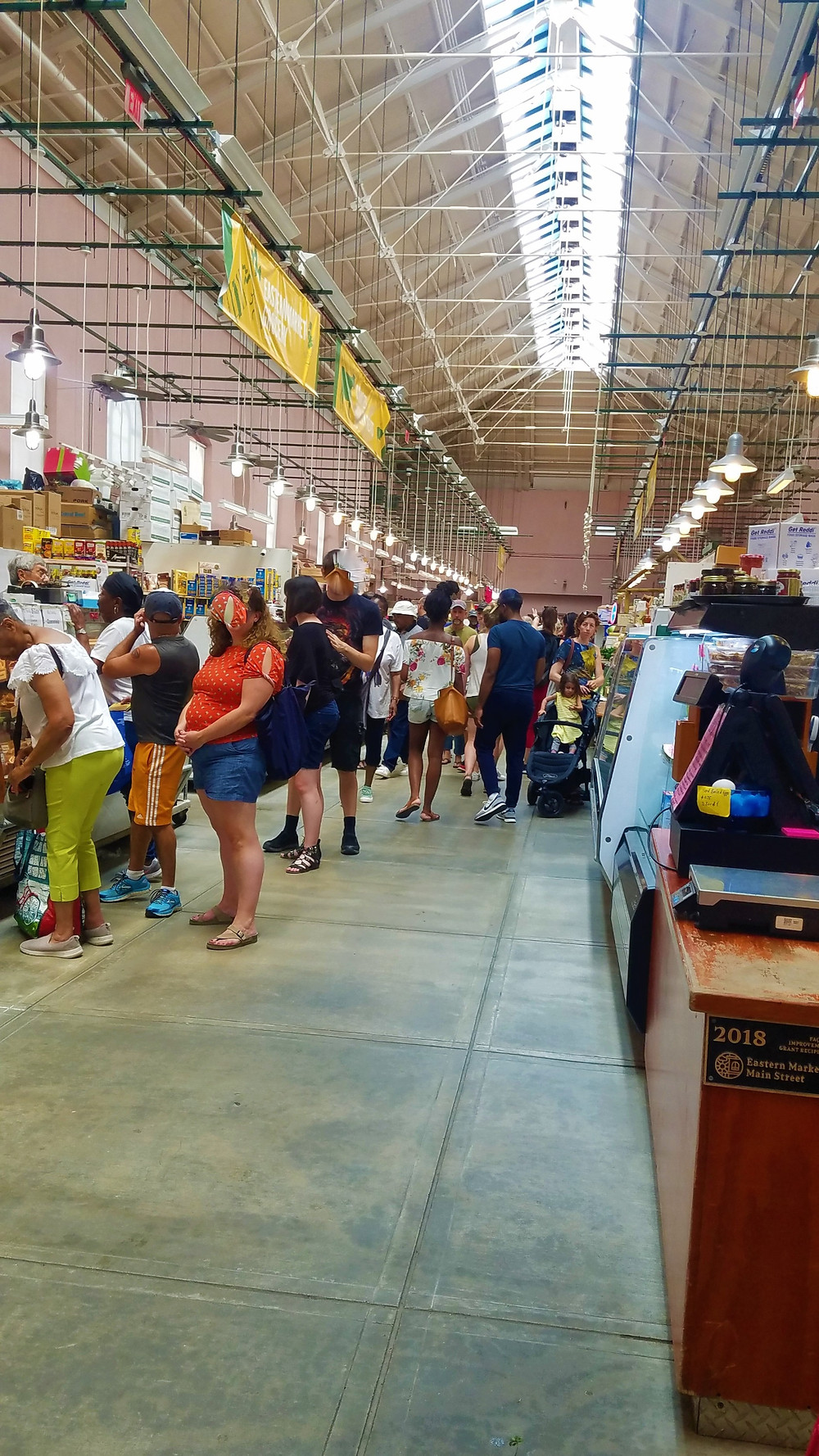 Photo inside the Eastern Market with people at counters