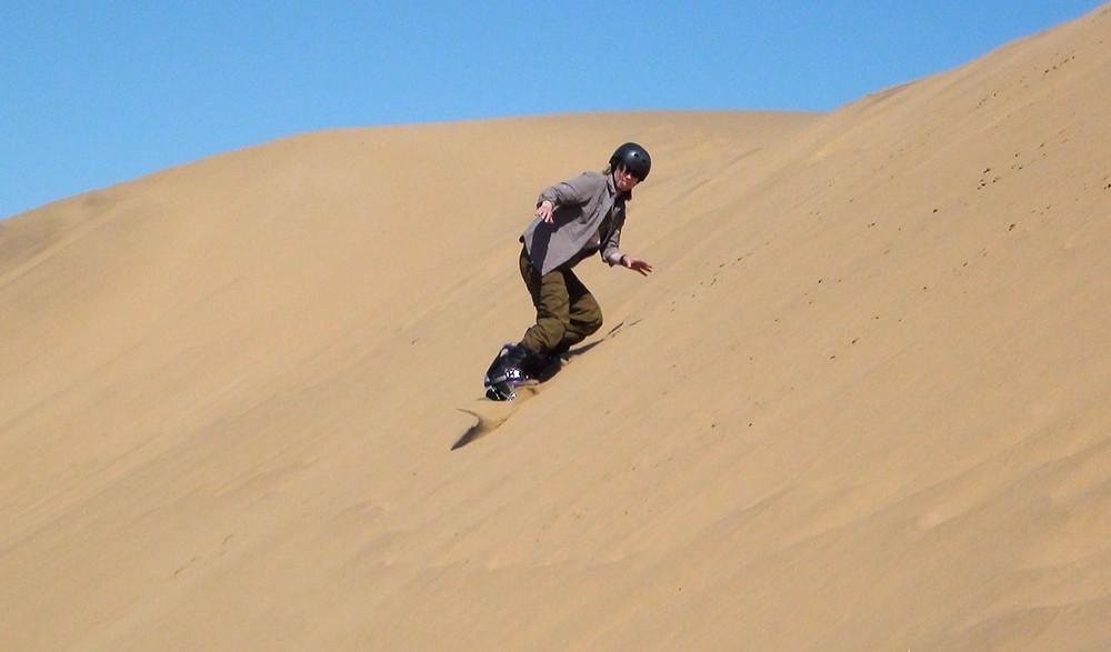 sandboarding in the Namib Desert in Nambia