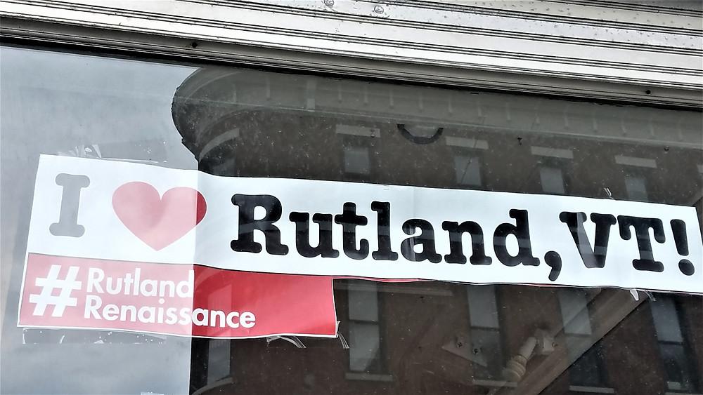 Photo of shopfront with I Love Rutland VT Banner
