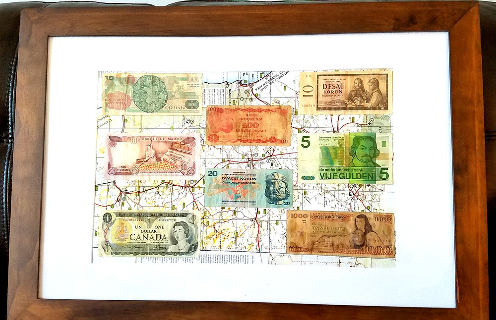 foreign currency framed on a map background