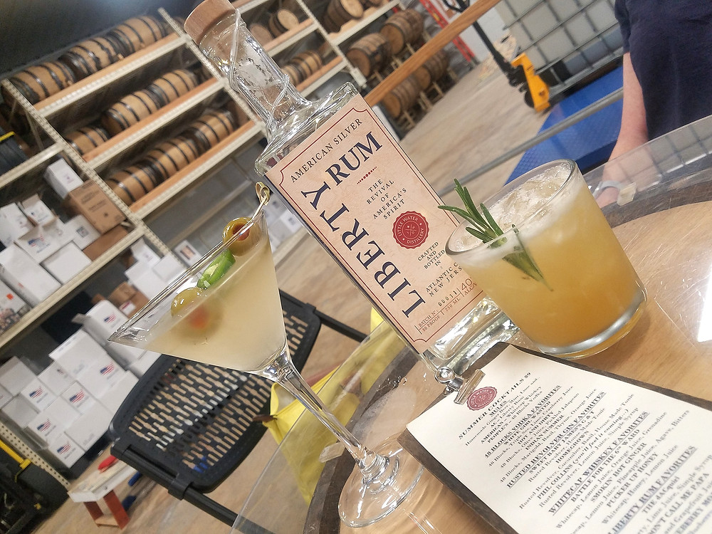 photo of cocktails on table inside warehouse distillery