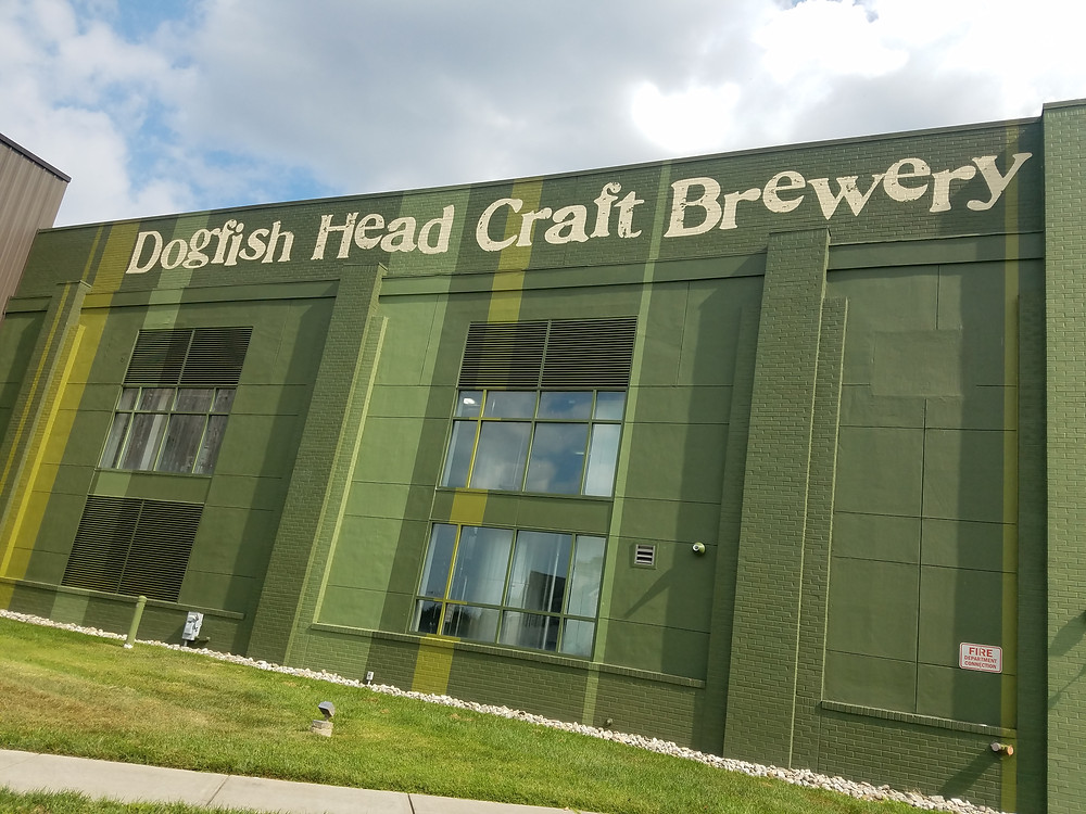 Outside green building of Dogfish Head Brewery